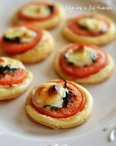 Mini Tomato and Mozzarella Tarts - puff pastry dough - olive oil - large yellow onion - 2 garlic cloves - kosher salt - pepper - chicken broth - fresh thyme - grated parmesan cheese - fresh mozzarella cheese - 2 roma tomatoes - fresh basil leaves