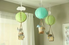 Project Nursery - Hanging Hot Air Balloons in this Adventure Themed Nursery