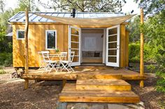 Off grid tiny house with solar panels and greywater system