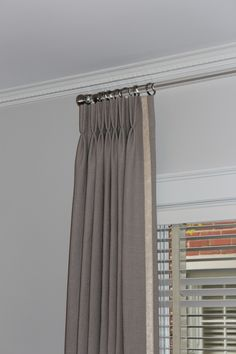 Pinch pleat panels with leading edge trim.