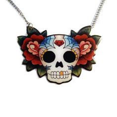 Created from an original Jubly-Umph illustration this necklace has a brightly decorated sugar skull between two roses.  Image is coated in glossy resin and is finished with stainless steel chain.