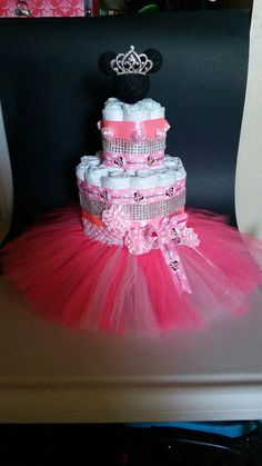 Check out this item in my Etsy shop https://www.etsy.com/listing/267574603/minnie-mouse-diaper-cake-pink-babyshower
