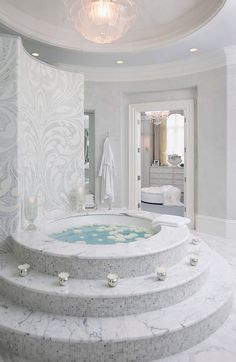 Not my ideal bath shape but let us take a moment to appreciate the tiers and the lovely vanity in the room beyond.