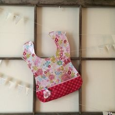 A personal favorite from my Etsy shop https://www.etsy.com/listing/268396206/boutique-girls-bib-toddler
