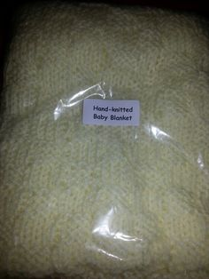 Hand knitted baby blanket - in soft yellow