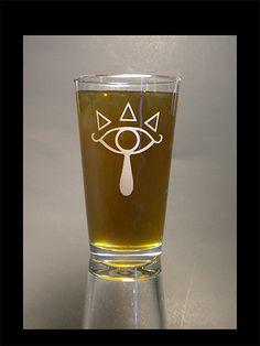 Sheikah emblem on a pint glass. $10.00, via Etsy.