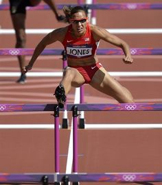 Day 10: Morning Session - Track & Field Slideshows | United States' Lolo Jones competes in a women's 100-meter hurdles heat during the athletics in the Olympic Stadium.  (Photo: Martin Meissner / Associated Press) #NBCOlympics