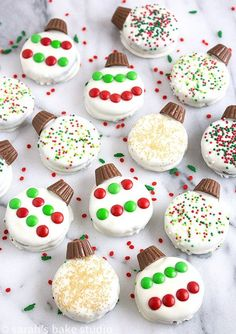 Oreo Ornaments – Oreo cookies dipped in white chocolate and decorated to look like a holiday ornament with peanut butter cup minis, and festive candies and sprinkles; stress-free Christmas cookie perfection. #EdibleChristmasGifts
