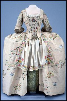Robe à l'Anglaise, England (Spitalfields), c. 1745, with later alterations. Ivory silk taffeta brocaded with silk in a pattern of sprays of flowers and strawberries with ribbon bows, all worked in blue, red, pink, green, purple and yellow.