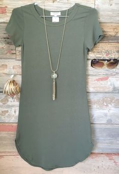 Live the dress style & color. Could be longer. Love the necklace