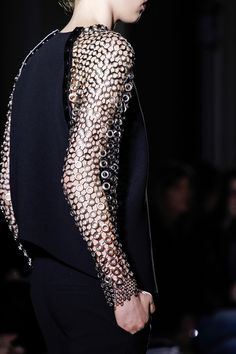 Top with chunky chain mail sleeves; armour fashion details // Anthony Vaccarello