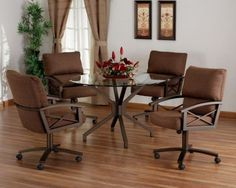 Swivel tilt caster glass top dining set by Tempo Furniture. The set is available in choices of fabric and metal finish. Available at www.discountdinettes.com.