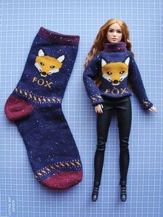 Clever! Turn a sock into a doll sweater!