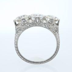 Antique Edwardian three stone diamond ring set in platinum