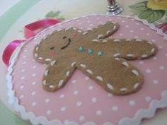 Gingerbread man ornament in felt - pic for inspiration - love the stitching and the ric-rac border