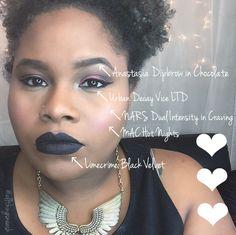 Glam look using black liquid lipstick and red eye shadow.