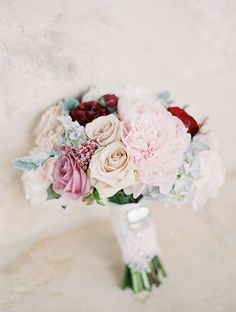 A Wedding Planners Rustic, Romantic Texas Wedding, Pale Bouquet with Pops of Red | Brides.com