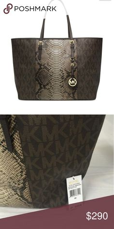 """AUTHENTIC MICHAEL KORS JET SET TRAVEL PYTHON TOTE This MICHAEL Michael Kors tote is an eye-catching piece to round out your collection.leather-and-synthetic,7"""" shoulder drop~ Open Top with Clasp Closure~ Interior Fully Fabric Lined ~ 4 Interior Open Pockets ~ One Interior Zip Pocket ~ Key Lanyard.   Front Center Goldtone Michael Kors Plaque ~Goldtone Hardware ~ Embossed Python Center with Signature Monogram MK Sides and Back .Carried once on vacay somehow got a little scratch on leather see…"""