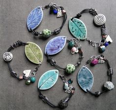 handcrafted porcelain jewelry by Nancy E. Schindler.  : )