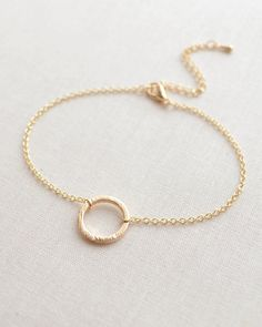 Simple Circle Bracelet in gold or silver. Small circle charm has a brushed texture. By Olive Yew.