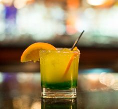 Midori Orange- a spash of Midori filled to brim with orange juice and sweet and sour.