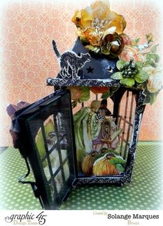 A gorgeous lantern by the amazing Solange using An Eerie Tale and Petaloo flowers #graphic45 #petaloo