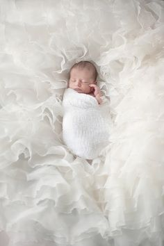 with glitter in her eyes newborn photos newborn dresses for weddings 1065x1600
