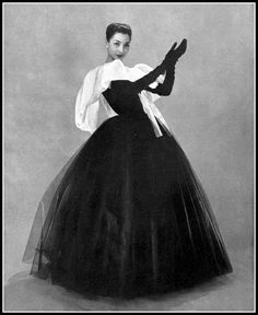 Renée Breton in full-skirted sheer black silk tulle gown illuminated by a broad white organdy collar, by Christian Dior, photo by Georges Saad, 1956 | by skorver1
