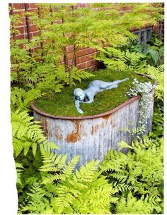 Re-purpose an old stock tank. I like the sculpture floating, or laying on a carpet of moss. Find more ideas @ www.ContainerWaterGardens.net
