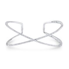 """Simple and elegant 14k white gold and diamond """"X"""" cuff bangle with a hinge, making it easy to put on and take off. Featuring 153 round brilliant diamonds, 0.63ctw."""