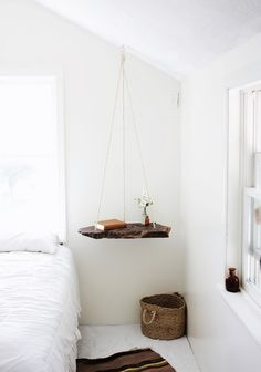 DIY floating nightstand in the form of a hanging table. Beautiful space saver for a small bedroom.