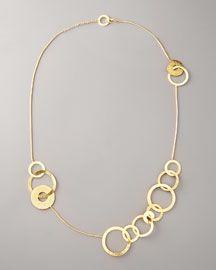 Van Der Straten gold disc necklace.