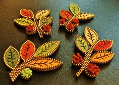 Felt and zipper leaf brooches by woolly  fabulous, via Flickr