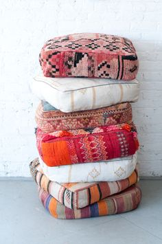 We can just stack these Moroccan Floor pillows all day, every day!