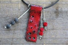 a fabulous statement necklace, red and grey with labradorite and coral beads, made by HammeredandFired on Etsy