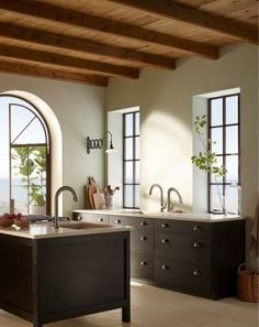 Sensate kitchen faucet Riverby kitchen sink Riverby kitchen sink This seaside kitchen blends the best of historic and modern California design. Mission-style features include rustic wood ceiling beams and an arched doorway that opens wide to the salt air. Home, Kitchen Remodel, Kitchen Design, Seaside Kitchen, Country Kitchen, Kitchen Colors, Beautiful Kitchens, Kitchens Bathrooms, Kitchen Styling