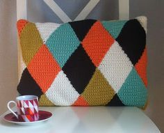 Free pattern for the lovely Fika cushion by inverleith - love the colors and pattern of this pillow!