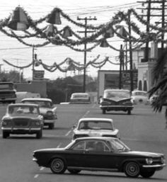 A 1958-59 Squarebird cruising Main St USA around Christmas time.