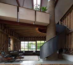 The Ancient Party Barn by Liddicoat & Goldhill in Kent, England | Liddicoat & Goldhill transforms an 18th-century barn into an English countryside home | black, wood, interior, brick, spiral staircase