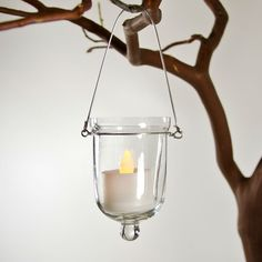 """Clear Glass Hanging Votive Holders  3.25"""" Tall by 2"""" Wide Votive Holder  6"""" Tall with Wire Hanger  Wire Hanger Included  *Candle Not Included @1.99"""