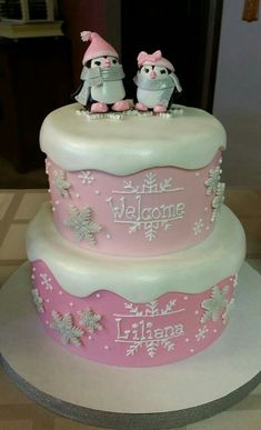 Pink little penguin and snowflake baby shower cake