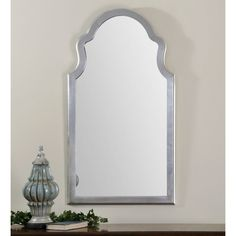 Uttermost Brayden Arched Silver Mirror - 27W x 48H in. - The Uttermost Brayden Arched Silver Mirror – 27W x 48H in. would look right at home flaunting its posh style in your foyer. This elegant accent...
