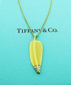 Tiffany Co Angela Cummings 18k Yellow Gold Platinum Diamond Leaf Necklace. Get the lowest price on Tiffany Co Angela Cummings 18k Yellow Gold Platinum Diamond Leaf Necklace and other fabulous designer clothing and accessories! Shop Tradesy now