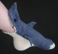 Socks that look like sharks are eating your leg and foot.