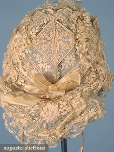2 WEDDING BONNETS, Lot: 465 April 2006 Vintage Clothing & Textile Auction New Hope, PA Both w/ Val lace, Broiderie Ainglaise & looped silk ribbon on wire foundations; 1 w/ sweetheart brim, (ribbons fragile on both) good Clothing And Textile, Antique Clothing, Historical Clothing, Vintage Gowns, Vintage Lace, Vintage Outfits, Belle Epoque, Victorian Fashion, Vintage Fashion