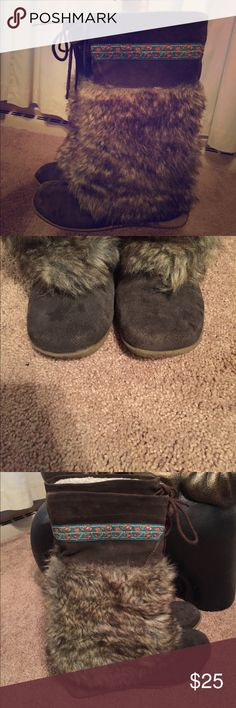 Size 7.5 adorable boots Check out these super cute boots!!!!  I absolutely love these things!  The fur is faux but the actual boot is genuine.  7.5 in size.  General wear.  See pictures.  The coloration on the front of the boot is a little uneven from wear.  There is no company label. Shoes Winter & Rain Boots