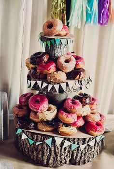 A three-tiered donut tower by Dough | Brides.com