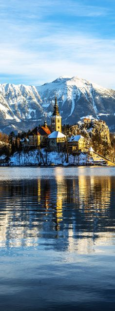 Scenic and atmospheric sunrise on Bled in Slovenia with Beautiful Castle   |   The 20 Most Stunning Fairytale Castles in Winter