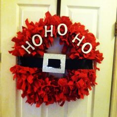 Santa Wreath! Perfect gift for the boyfriends family: red burlap cut in strips and tied to a wire wreath, a black satin ribbon, a glittery paper square cut into a buckle, and some glittery white wooden lettering! #bg #bgoriginal #hohoho #christmas #wreath #diy #holidays