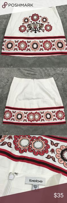 Bebe embroidered mini skirt boho floral In excellent condition, missing fabric content tag, feels like linen bebe Skirts Mini